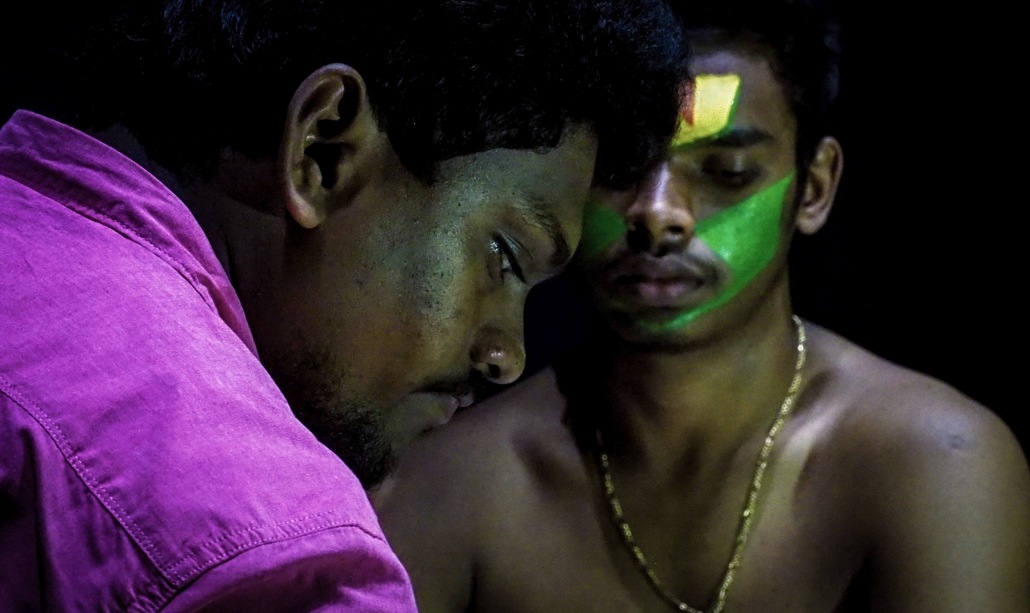 Traditional Indian Kathakali actor having make up appiled